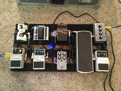 Current pedalboard arrangement. Homemade Sir Mix-a-lot pedal mixes my guitar and keyboard signals at the input, various homemade and commercial pedals in between, and the Boss Line Switcher switches between the two amps at the output