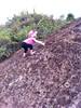 Climbing rocks along the trail