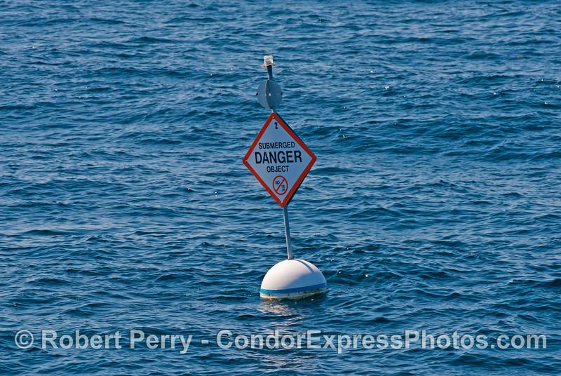 A buoy marks an old oil platform east of Platform Hogan.