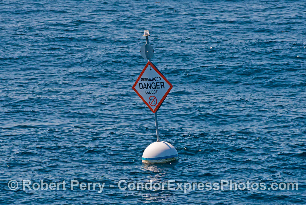 A buoy marks an old oil platform east of Platform Hogan.