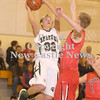 Erica Galvin/NEWS<br /> Laurel's Jacob Wilson shoots around Mohawk's Jonathan Grim in the first quarter.