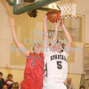 Erica Galvin/NEWS<br /> Mohawk's Lucas Grim and Laurel's Josh Finley fight for a rebound in the second quarter.