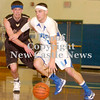 Erica Galvin/NEWS<br /> Union's Joe Salmen drives to the hoop against OLSH's Stefan Arch in the first half.