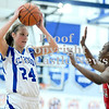 Courtney Caughey-Stambul/NEWS<br /> Ellwood City's Karington Ketterer makes a move against New Castle's Kelsey Scott.
