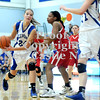 Courtney Caughey-Stambul/NEWS<br /> Ellwood City's Karington Ketterer attempts to hand-off the basketball as New Castle's Velvet Wade defends.