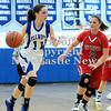 Courtney Caughey-Stambul/NEWS<br /> Ellwood City's Bailey McKinney drives to the basket as New Castle's Rachael Razzano defends.