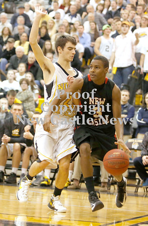 Erica Galvin/NEWS<br /> New Castle's Drew Allen drives the baseline against North Allegheny's Joe  Mancini.