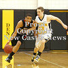 Erica Galvin/NEWS<br /> Shawn Anderson drives down the court as North Allegheny's  David Haus defends.