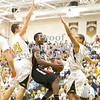 Erica Galvin/NEWS<br /> New Castle's Malik Hooker shoots between the North Allegheny defense