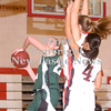 Erica Galvin/NEWS<br /> Laurel's Ellen Shaffer shoots around the Neshannock defense in the second quarter.