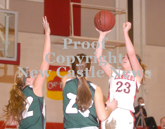 Erica Galvin/NEWS<br /> Neshannock's Madison McHale shoots over the Laurel defense in the fourth quarter.