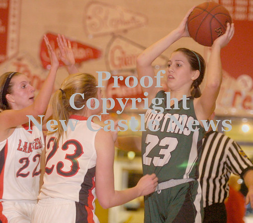 Erica Galvin/NEWS<br /> Laurel's Kristan Fedrizzi looks for an open teammate while Neshannock's Tayler Grybowski, left and Madison McHale (23) defend.