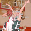 Erica Galvin/NEWS<br /> Laurel's Ellen Shaffer fouls  Alexandra Fischer in the third quarter last night.
