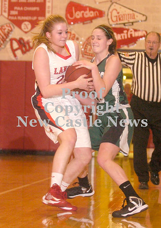 Erica Galvin/NEWS<br /> Neshannock's Madison McHale  and Laurel's Kristin Dicks fight for a jump ball in the first half.