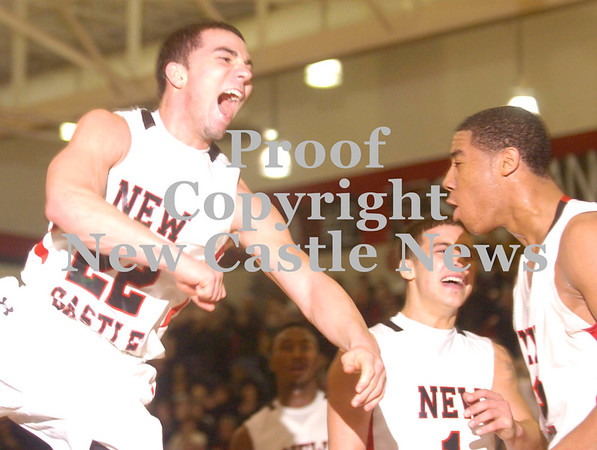 Erica Galvin/NEWS<br /> Anthony Richards, left,  celebrates with Brandon Domenick and Shawn Anderson, right, after Anderson made a shot while being fouled for a potential 3-point play.
