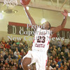 Erica Galvin/NEWS<br /> Malik Hooker dunks the ball in the second quarter.