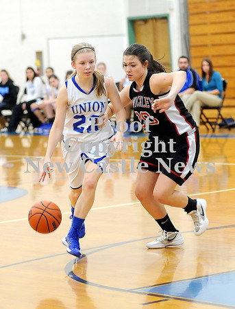 Courtney Caughey-Stambul/NEWS<br /> Union's Marissa Heaney drives to the basket against Sewickley Academy's Riley Roberts.