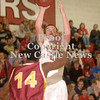 Erica Galvin/NEWS<br /> John Hartzell shoots over New Brighton's Ta'Shaun Goode.