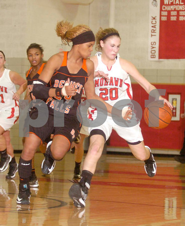 Erica Galvin/NEWS<br /> Beaver Falls player Ayana Vaughn fouls Mohawk's Shelby Brown in the fourth quarter.