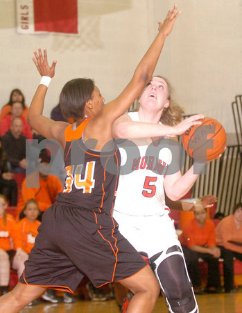 Erica Galvin/NEWS<br /> Mohawk's Katie Hoover shoots over Beaver Falls' Tiffany Wright in the first quarter.
