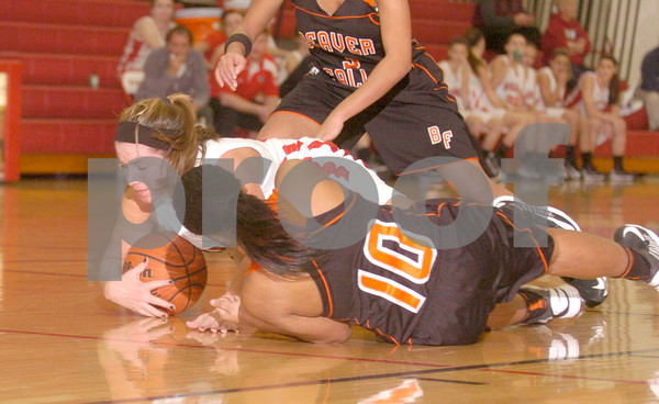 Erica Galvin/NEWS<br />  Mohawk's Lucia Fee and Beaver Falls' TreAuna Slappy go after a loose ball in the first half.
