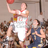 Erica Galvin/NEWS<br /> Neshannock's Ernie Burkes makes a lay-up while Shenango's Greg DePorzio defends.