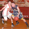 Erica Galvin/NEWS<br /> Shenango's Brenton Booher drives to the hoop as Neshannock's Matt Seltzer defends.