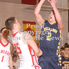 Erica Galvin/NEWS<br /> Shenango's James Jacobs shoots over Neshannock's Tyler Haswell in the first quarter.