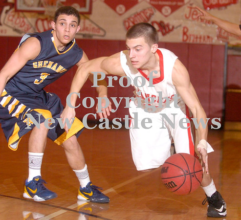 Erica Galvin/NEWS<br /> Neshannock's Ernie Burkes dribbles past Shenango's Greg DePorzio in the second half.