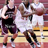 Courtney Caughey-Stambul/NEWS<br /> New Castle's Kelsey Scott drives the lane as Ambridge's Kelly Haslett defends.