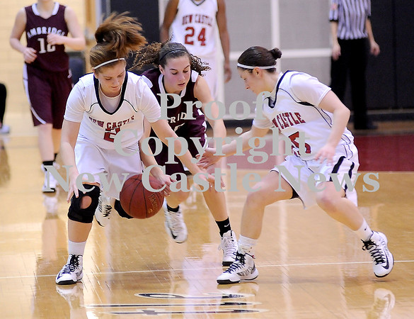 Courtney Caughey-Stambul/NEWS<br /> New Castle's Rachael Razzano, left, Dana Perrotta, right, and Ambridge's Sydney Rabold go after a loose ball.