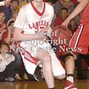 Erica Galvin/NEWS<br /> Ethan Moose dribbles down the court in the third quarter.