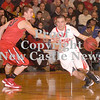 Erica Galvin/NEWS<br /> Neshannock's Ernie Burkes drives to the hoop as Mohawk's Hunter Kursel defends.