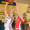 Erica Galvin/NEWS<br /> Neshannock's Alexandra Fischer blocks the shot of Shenango's Amanda Herb.
