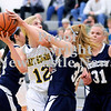 Courtney Caughey-Stambul/NEWS<br /> Wilmington's Tessa Sikora is fouled by Mercer's Aubrie Angermeier.