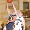 Erica Galvin/NEWS<br /> Laurel's Stephen Avery fouls Shenango guard James Jacobs in the second half.