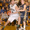Erica Galvin/NEWS<br /> Laurel's Josh Dando drives to the hoop against Shenango's Brian Tanner in the first quarter.