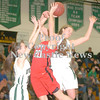 Erica Galvin/NEWS<br /> Riverside's Hayley Thewes, left, and Nicole Mansfield foul Mohawk's Shelby Brown in the third quarter.