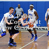 Courtney Caughey-Stambul/NEWS<br /> Union's Markel Peace, left, guards Lincoln Park's Maverick Rowan last night as teammates, Benjamin Young, center, and Drew Robinson move in to help.