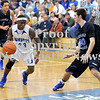 Courtney Caughey-Stambul/NEWS<br /> Union's Benjamin Young drives to the basket against Lincoln Park's Nate Loedding.