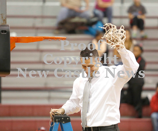 Erica Galvin/News<br /> <br /> New Castle head coach Ralph Blundo holds up the net after cutting down after being named section champs.