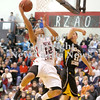 Erica Galvin/NEWS<br /> Shawn Anderson shoots around North Allegheny's James Meeker in the second quarter.