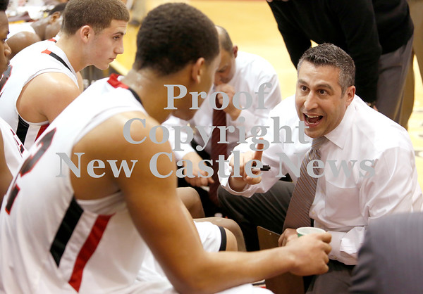 Erica Galvin/NEWS<br /> New Castle head coach Ralph Blundo talks to his players before the start of the fourth quarter.