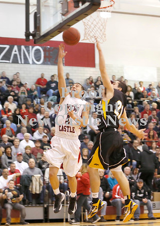 Erica Galvin/NEWS<br /> Brandon Domenick shoots a lay-up in the first quarter as North Allegheny's Adam Haus defends.