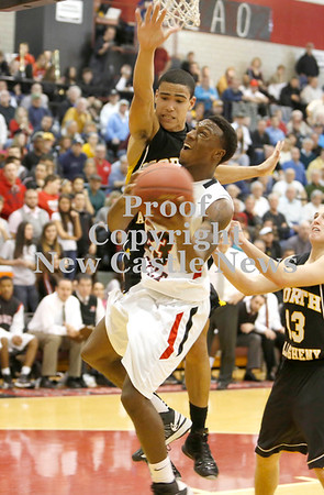 Erica Galvin/NEWS<br /> North Allegheny's Elijah Zeise fouls Malik Hooker in the fourth quarter.