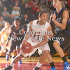 Erica Galvin/NEWS<br /> Shawn Anderson drives the baseline against Perry's Marcus Dean.