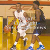 Erica Galvin/NEWS<br /> Malik Hooker drives to the hoop against Perry's Shakeem Cox.