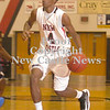 Erica Galvin/NEWS<br /> Antonio Rudolph drives to the hoop in the first quarter.