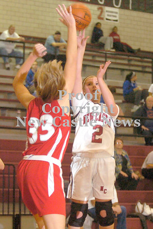 Erica Galvin/NEWS<br /> New Castle's Rachael Razzano shoots over Neshannock's Alexandra Fischer in the first quarter.