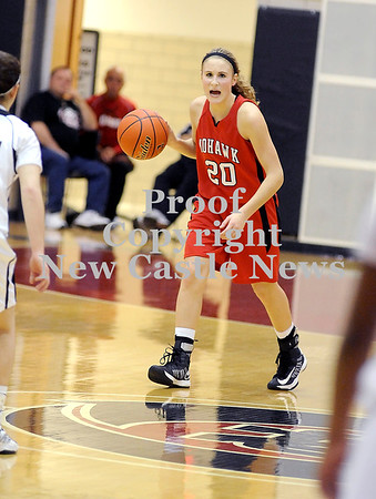 Courtney Caughey-Stambul/NEWS<br /> Mohawk's Shelby Brown brings the ball up the floor against New Castle.